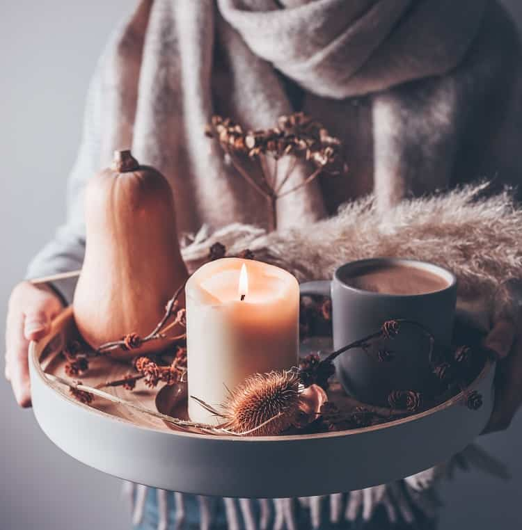 fall decor with a candle centerpiece.